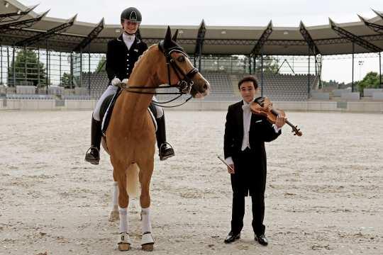 """Johanna Kullmann riding """"Casino Royale"""" and Enzo Kok in the Deutsche Bank Stadium. Photo: CHIO Aachen"""